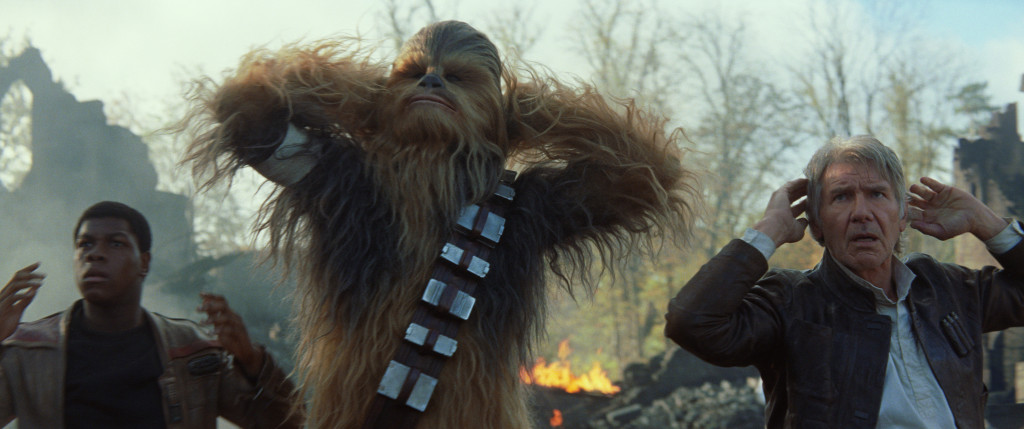 Star Wars: The Force Awakens..L to R: Finn (John Boyega), Chewbacca (Peter Mayhew), and Han Solo (Harrison Ford)..Ph: Film Frame..? 2014 Lucasfilm Ltd. & TM. All Right Reserved..