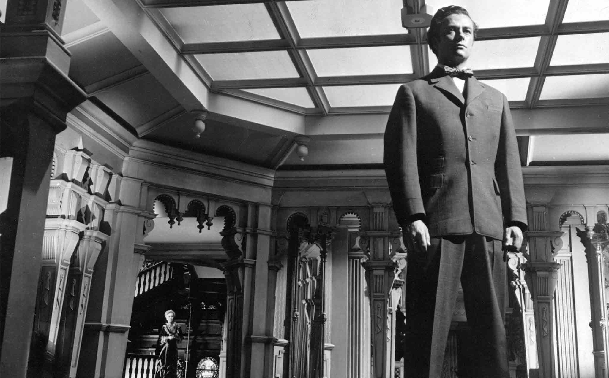 The Magnificent Ambersons (1942) Directed by Orson Welles Shown from left: Dolores Costello (in background, as Isabel), Tim Holt (as George)