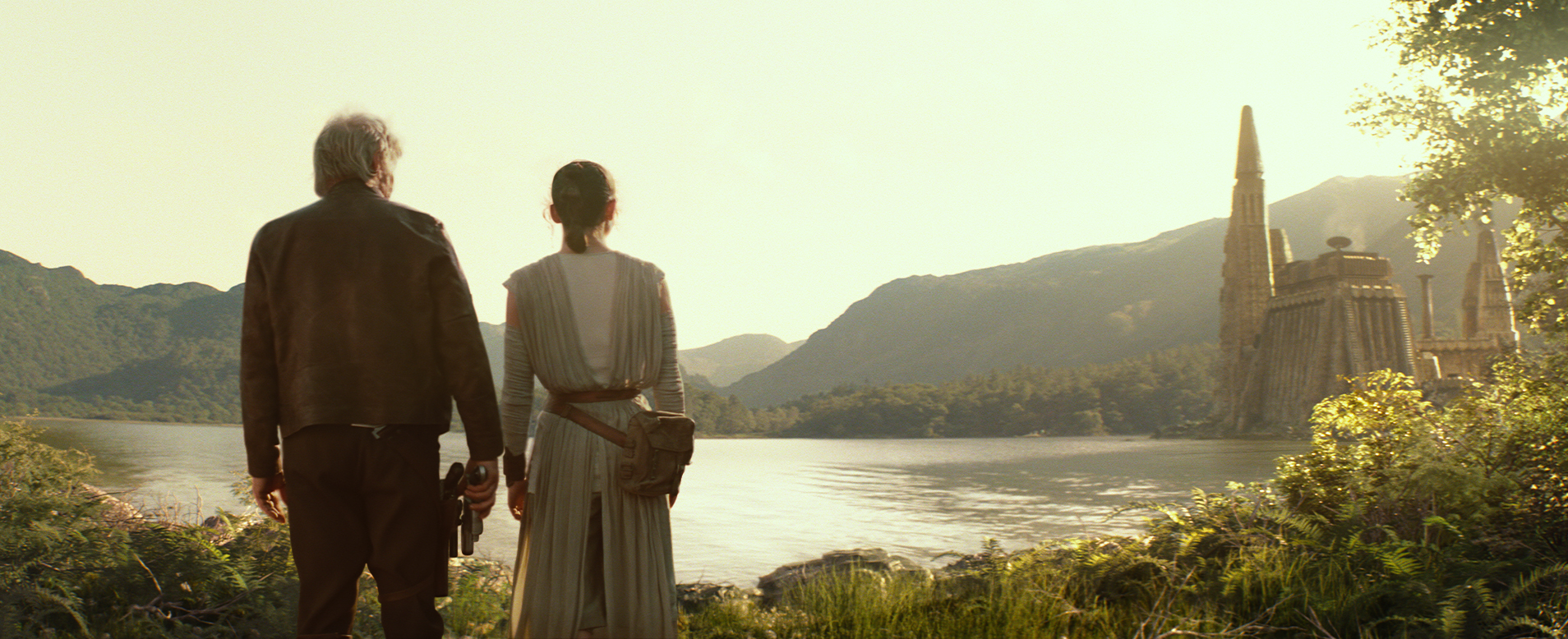 Star Wars: The Force Awakens..L to R: Han Solo (Harrison Ford) and Rey (Daisy Ridley) w/ Castle Takodana in background...Ph: Film Frame..? 2014 Lucasfilm Ltd. & TM. All Right Reserved..