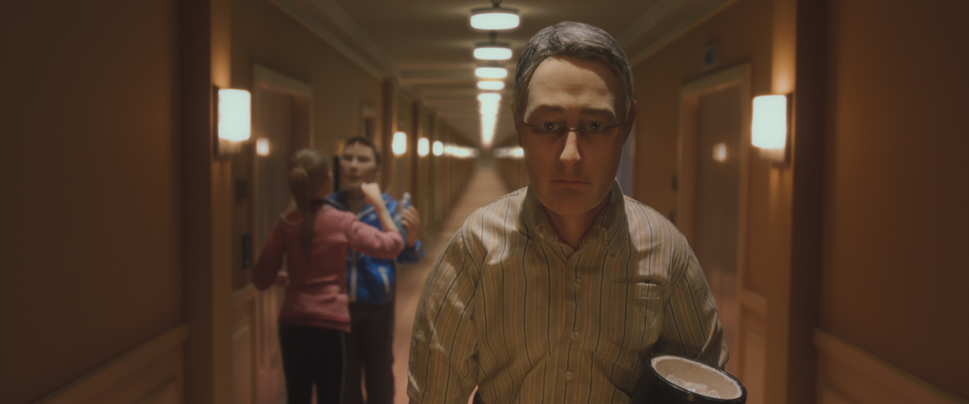 (L-R) Tom Noonan voices Hotel Guests, Wife & Husband and David Thewlis voices Michael Stone in the animated stop-motion film, ANOMALISA, by Paramount Pictures